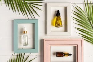 Various CBD massage oils in pastel frames on a wall